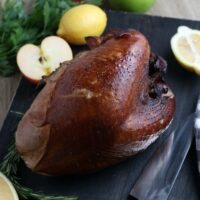 finished smoked turkey breast served with apples and oranges