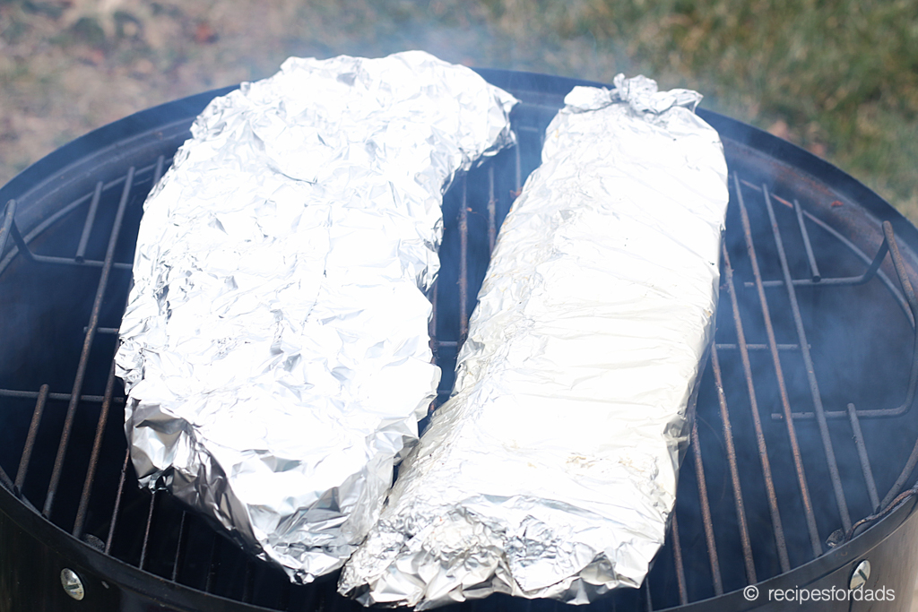 Wrapping ribs in foil and placed back on smoker