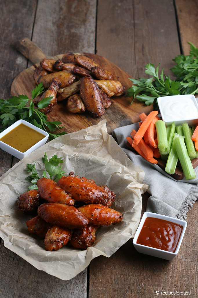 Serving smoked chicken wings with your favorite sides like carrots and celery, with dipping sauces