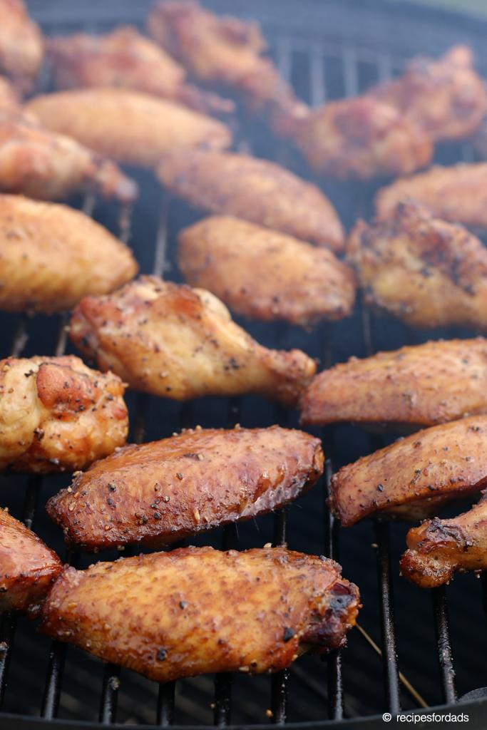 Smoked wings cooking on Weber smoker