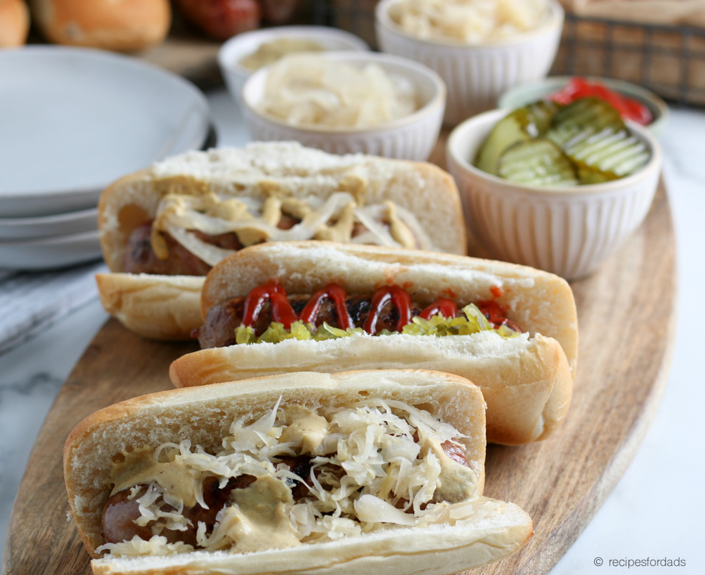 Beer Brats served with sauerkraut and mustard, with a red and white checkered napkin