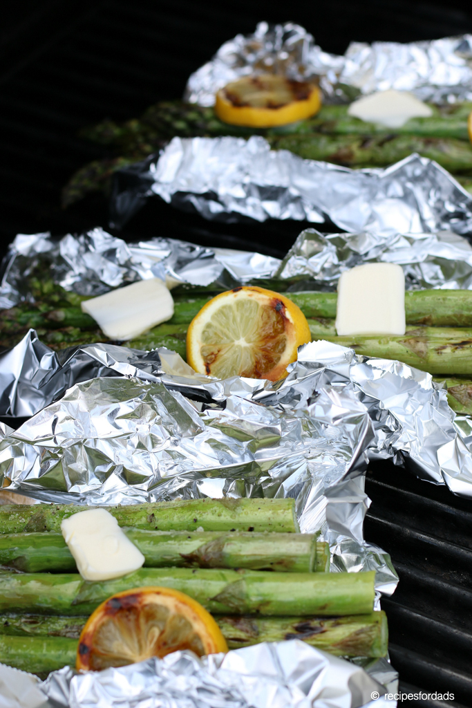 grilled asparagus in foil, topped with butter and lemon