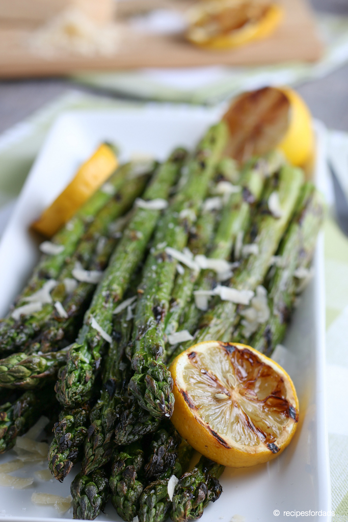 Grilled asparagus topped with parmesan cheese and lemon