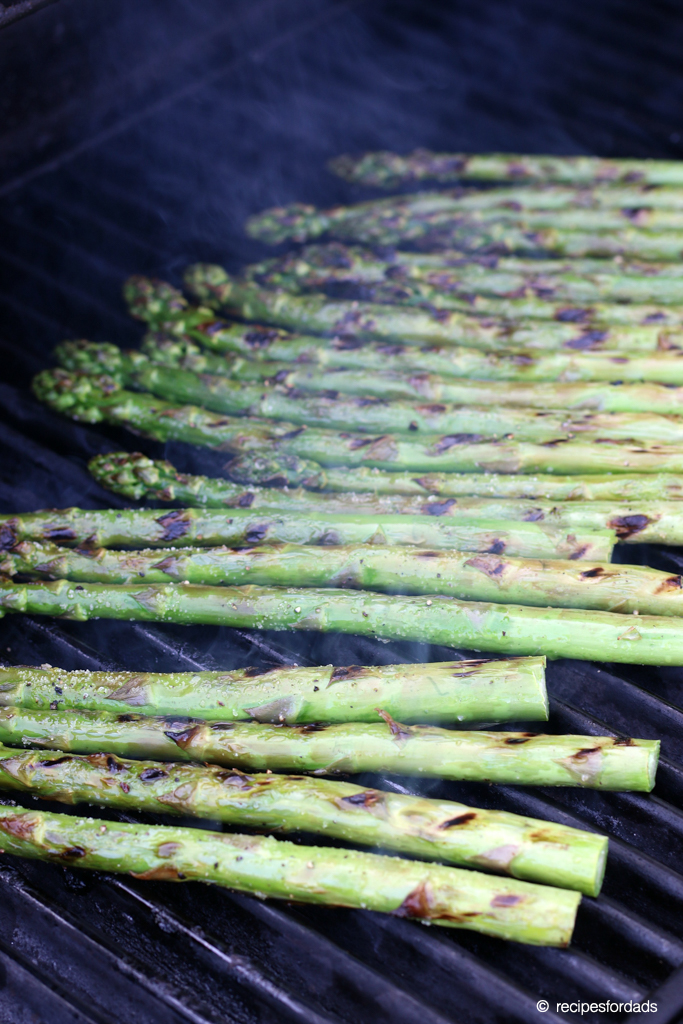 Asparagus cooking over the grill