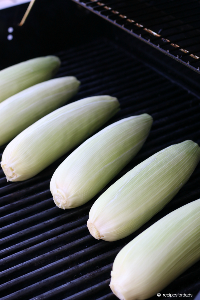 grilling corn on the cob with husks on