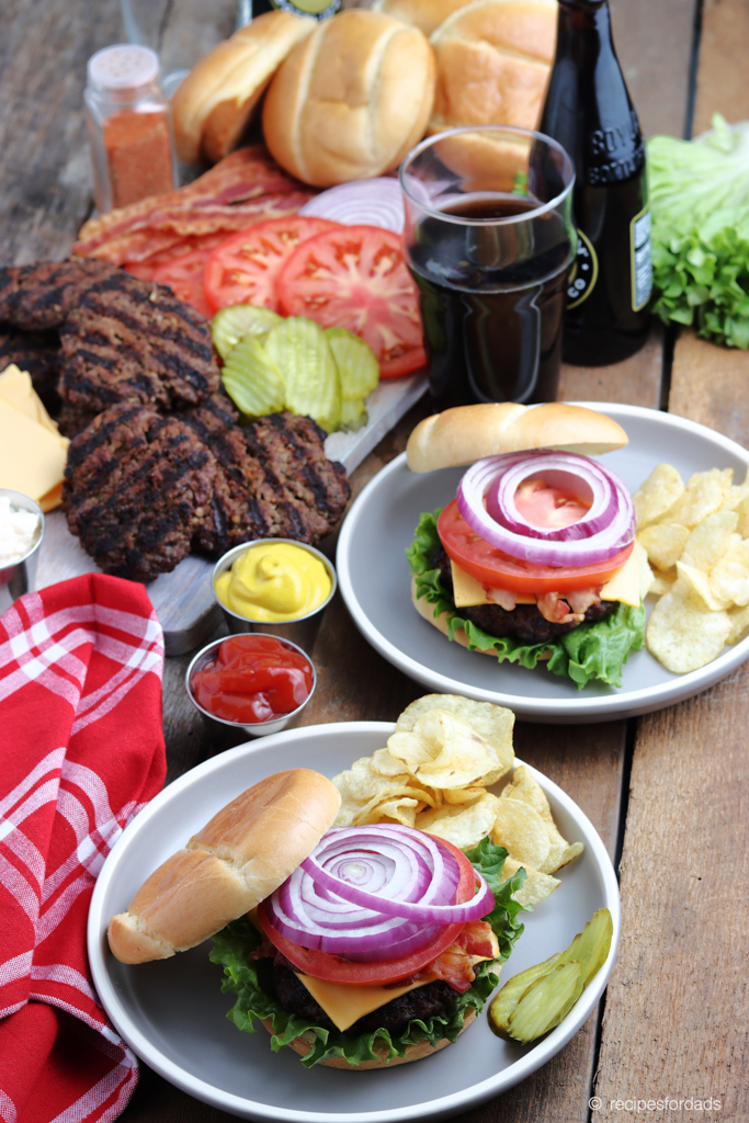 Best Burger Recipe is served up with tomatoes, pickles, lettuce and buns