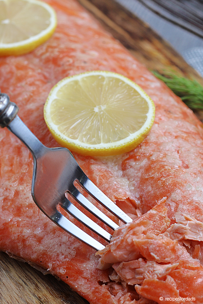Fork cutting into flavorful and tender smoked salmon