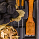 woodchips with charcoal and grilling set
