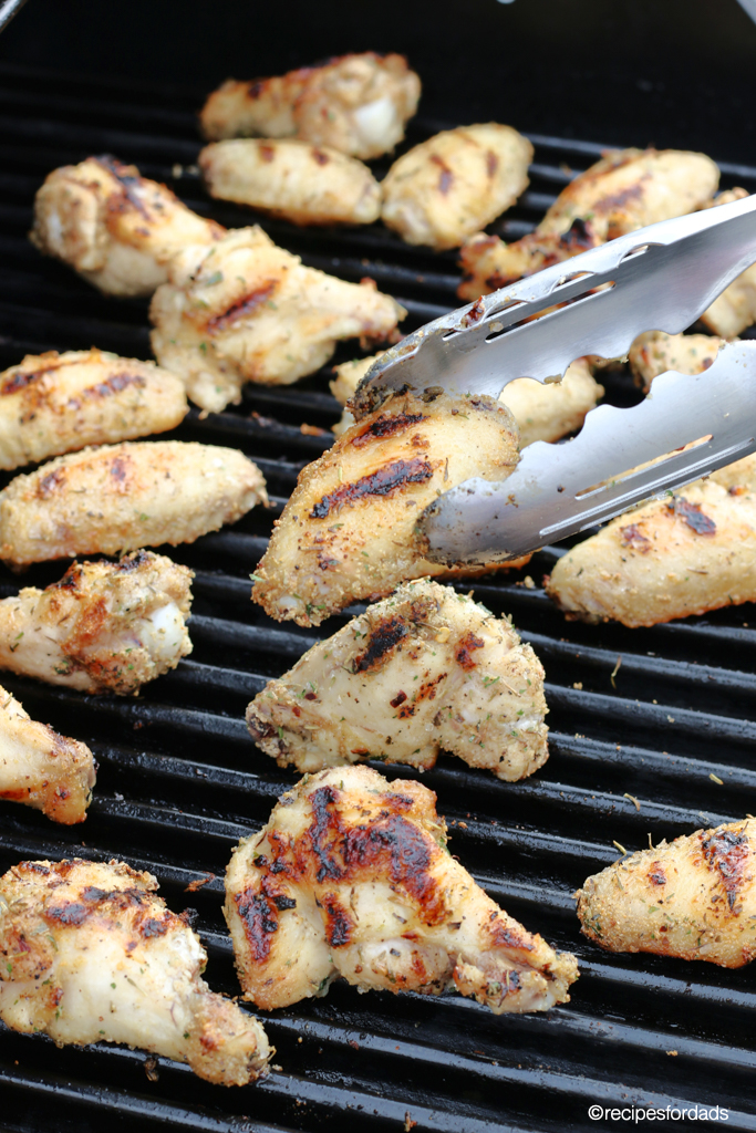 Flipping chicken wings on grill frequently