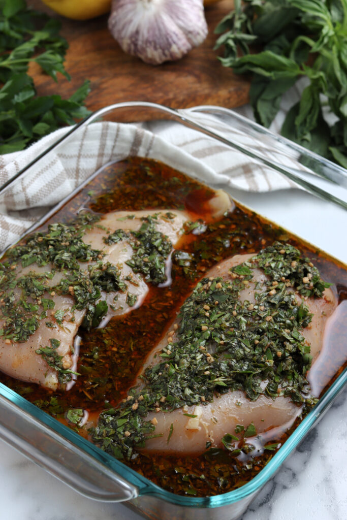 Chicken breasts seasoned with oils, oregano and parsley.
