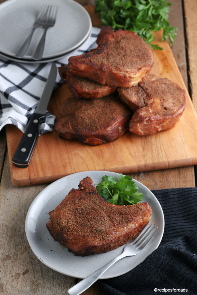 Smoked Pork chop on white dish
