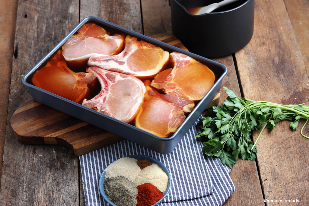 pork chops marinating in brine