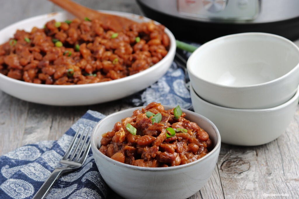 bbq beans served in white bowl with instant pot