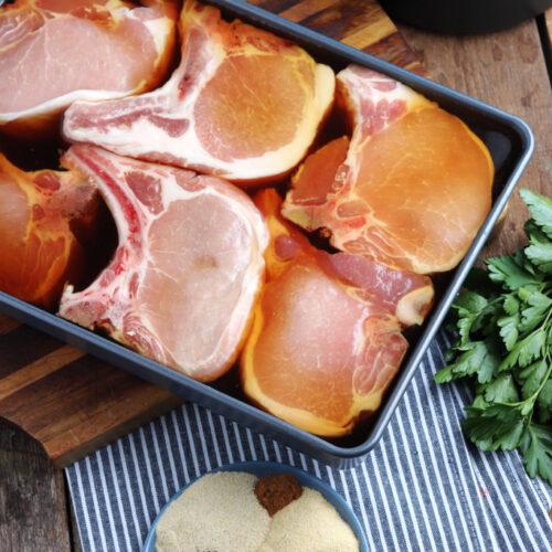 pork chop marinating in pan